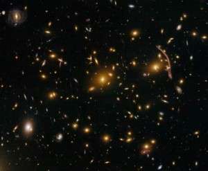 Gravitational lensing by a cluster of galaxies. The large arc-like objects are galaxy images which have been severely gravitationally lensed.
