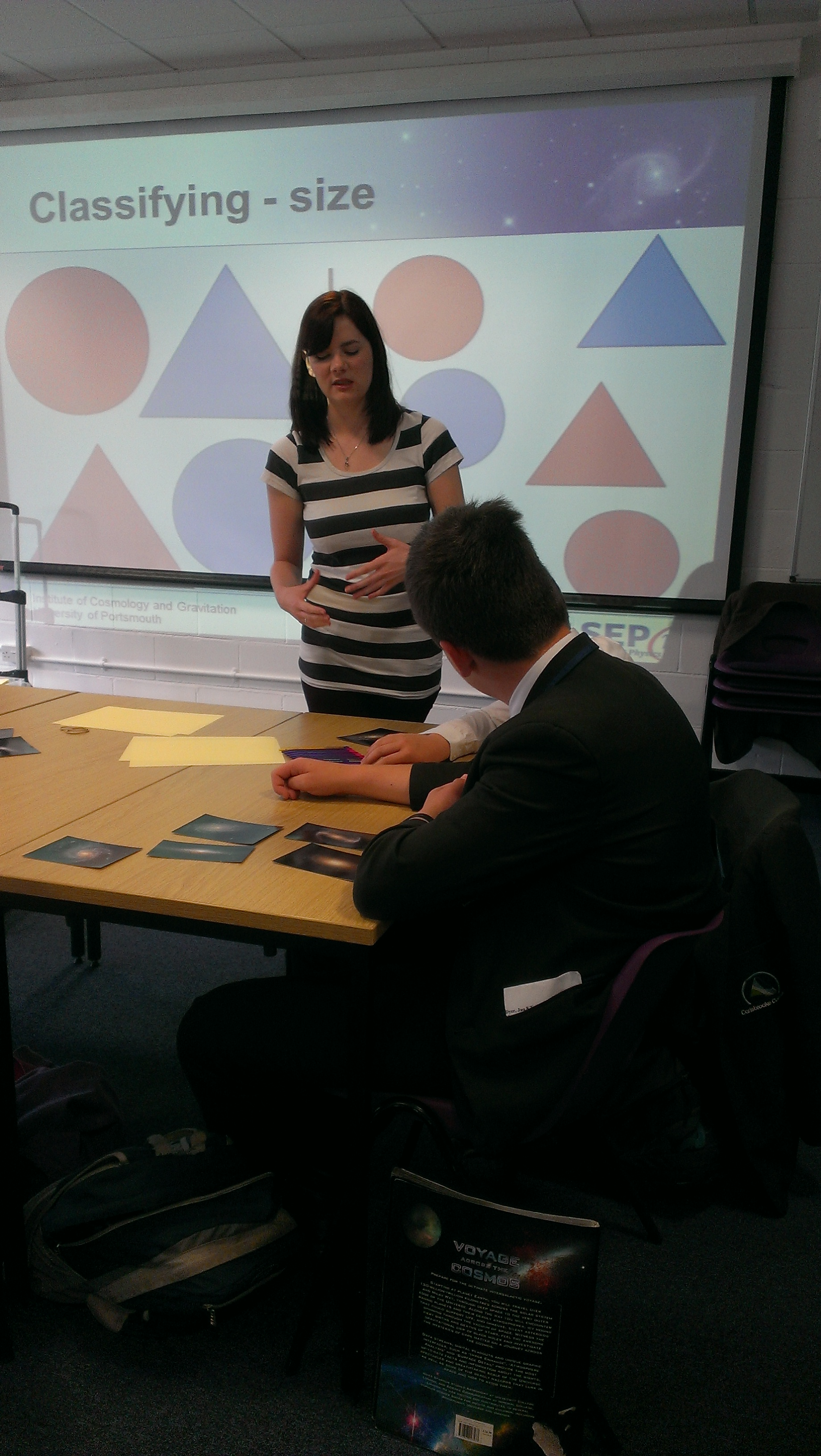 Claire Le Cras explaining galaxy shapes at Think Bigger in 2013.