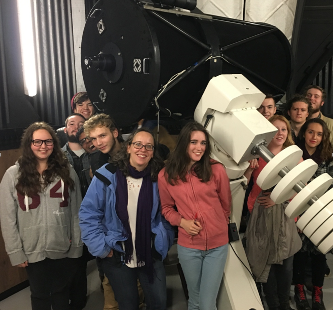 "Dr. Karen Masters with several of the first year physics students in the Clanfield 24"" Dome."